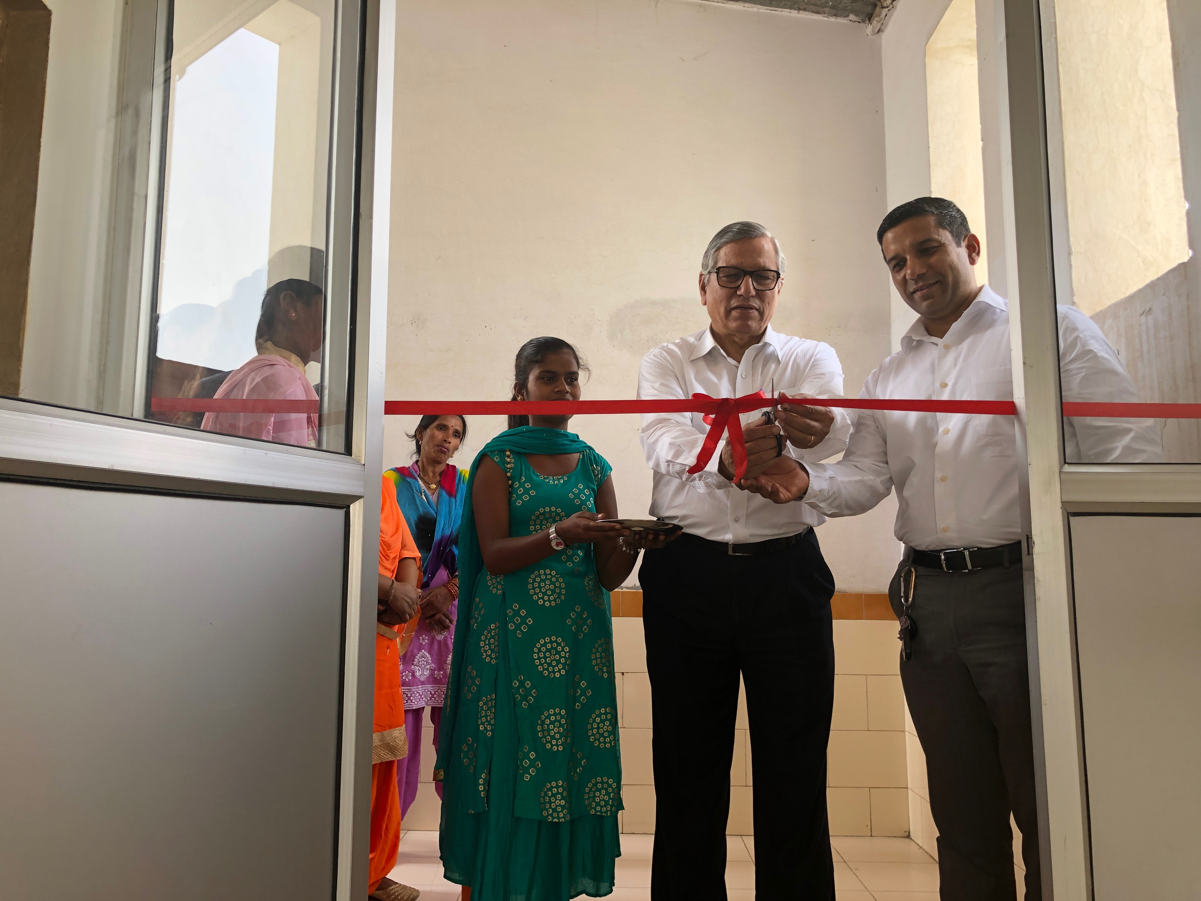 Cutting the ribbon at the inauguration of the sewing centre